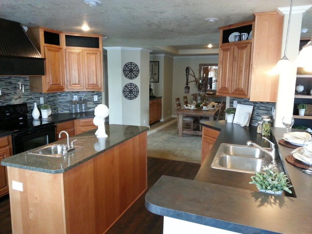 The ING501K PONDEROSA    (FULL) GW Kitchen. This Manufactured Mobile Home features 3 bedrooms and 2 baths.