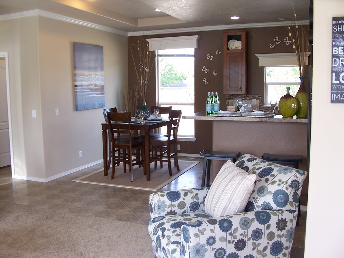 The PREFERRED PLUS CP441F Dining Area. This Manufactured Mobile Home features 3 bedrooms and 2 baths.