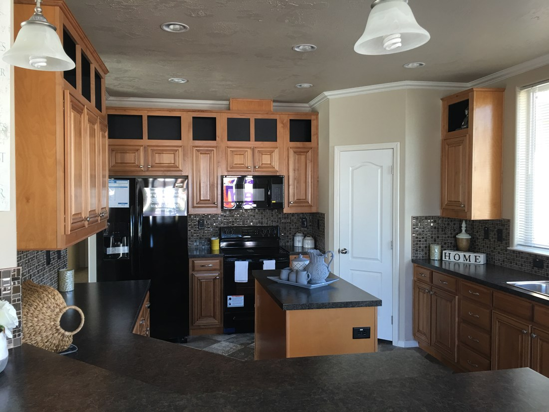 The PREFERRED PLUS CP601F Kitchen. This Manufactured Mobile Home features 3 bedrooms and 2 baths.