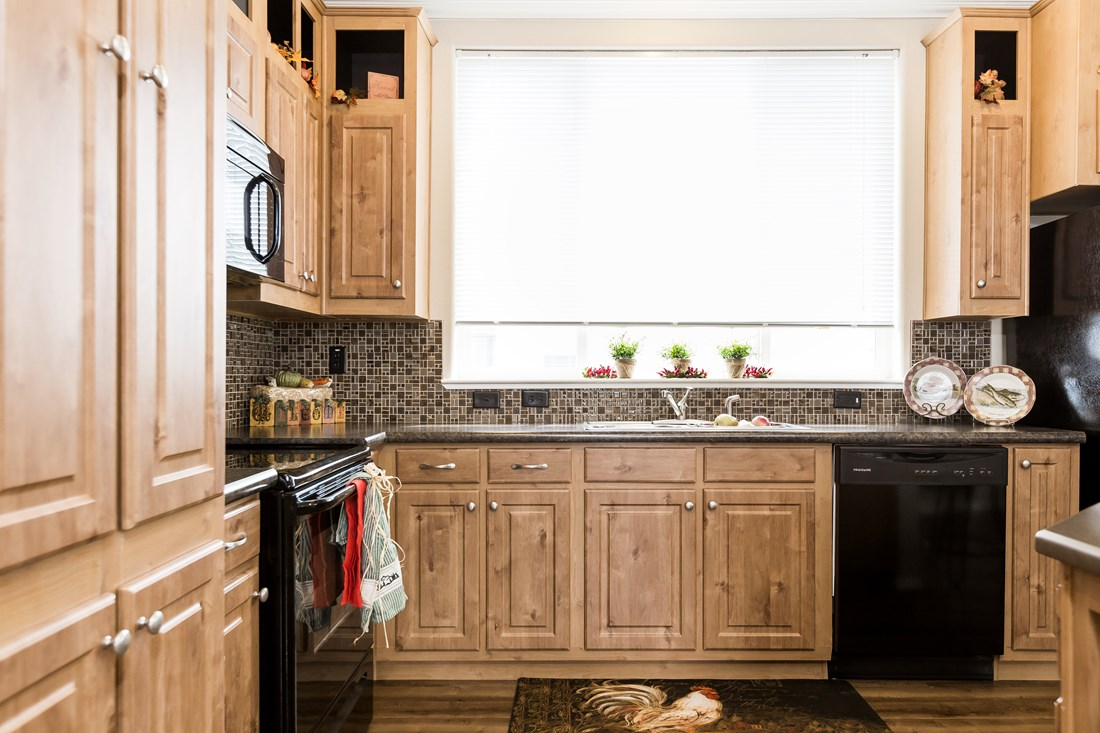 The PREFERRED PLUS CP522F Kitchen. This Manufactured Mobile Home features 3 bedrooms and 2 baths.