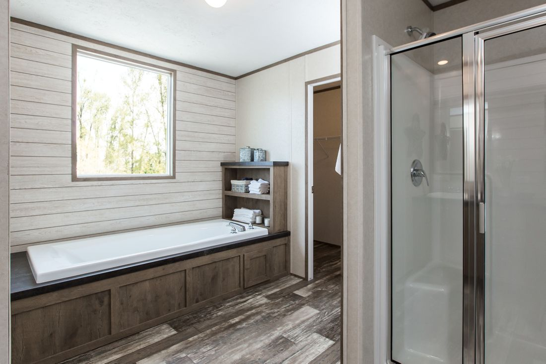 The THE BREEZE 2.5         CLAYTON Master Bathroom. This Manufactured Mobile Home features 4 bedrooms and 2 baths.