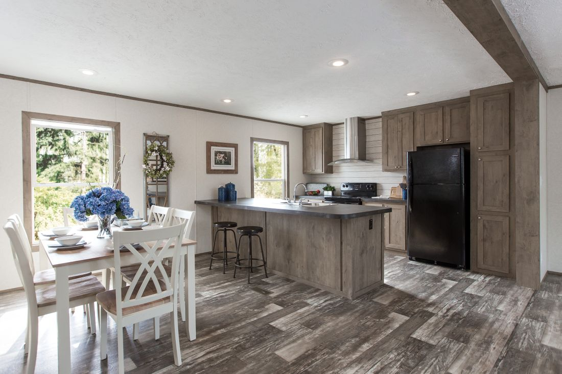 The THE BREEZE 2.5         CLAYTON Kitchen. This Manufactured Mobile Home features 4 bedrooms and 2 baths.