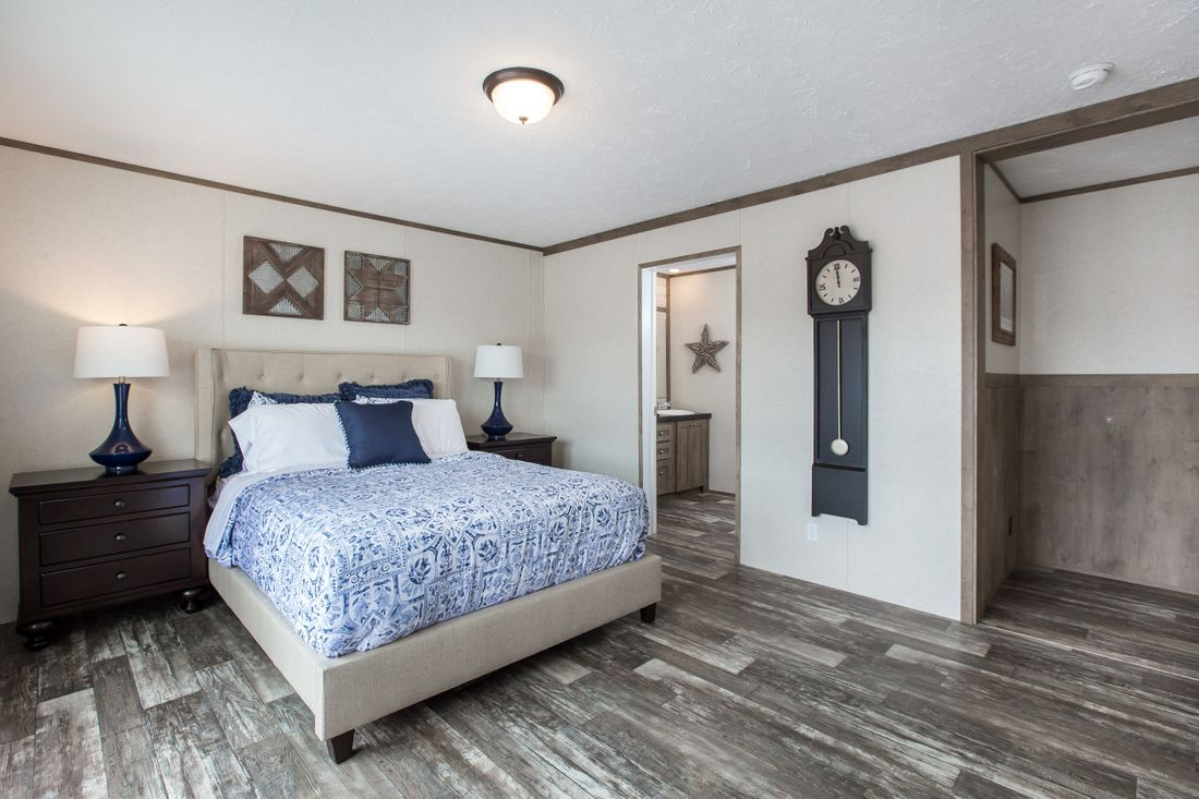The THE BREEZE 2.5         CLAYTON Master Bedroom. This Manufactured Mobile Home features 4 bedrooms and 2 baths.