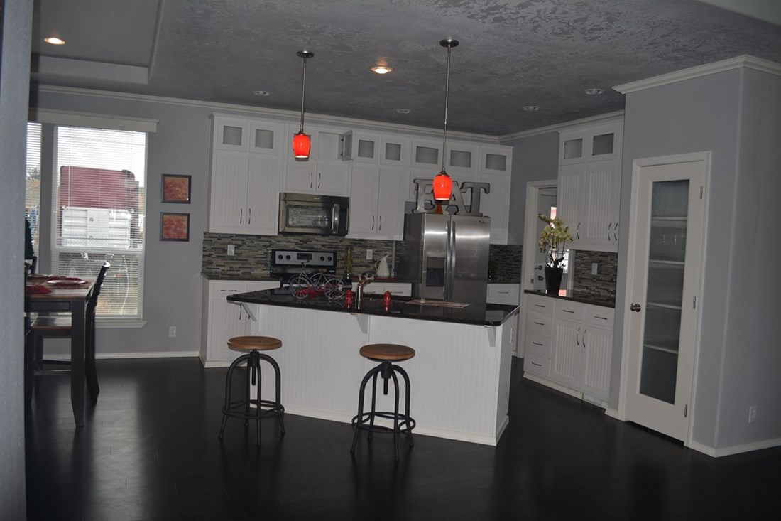 The THE EUCALYPTUS Kitchen. This Manufactured Mobile Home features 3 bedrooms and 2 baths.